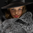 Portrait beautiful young lady in grey fur and hat — Stock Photo