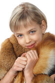 Beautiful young blond girl in fur — Stock Photo