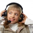 Stock Photo: Blond teenage girl in headphones