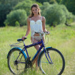 Sexy girl with bicycle - Stock Photo