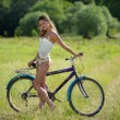 Sexy girl with bicycle — Stock Photo #5294763
