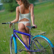 Sexy girl with bicycle — Stock Photo