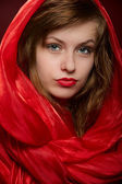 Young girl in a red hood — Stock Photo
