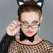 Sexy woman with cat ears on grey background — Stockfoto