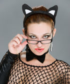 Sexy woman with cat ears on grey background — Stock Photo