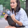 Royalty-Free Stock Photo: Woman with laptop in city park