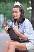 Woman with laptop in city park — Stock Photo