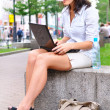 Young woman is closing laptop after work at city park — Stock Photo #4052270