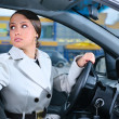 Woman in a car is looking backwards trying to move back — Stock Photo