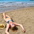 Sexy woman is lying on the beach and, top view — ストック写真