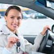 Happy woman is showing keys of her new car — Foto Stock