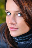 Close up portrait of a beautiful young brown haired woman lookin — Stock Photo