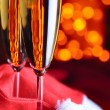 Royalty-Free Stock Photo: Two champagne glasses on red silk