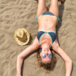 Top view of a slim woman is lying on the beach — Stock Photo
