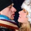 Attractive young couple is kissing at winter evening — Stock Photo