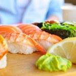 Eating japanese food — Stock Photo