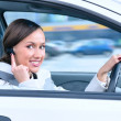 Beautiful woman driver is safely talking phone in a car using a - Stock Photo