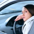 Beautiful sensual woman put her head on steering wheel and looki — Stock Photo