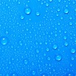 Blue water drops on glass — Foto Stock