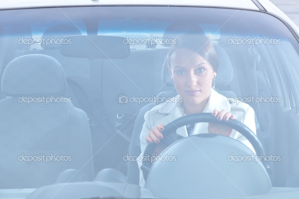 Beautiful woman is sitting in her car — Stock Photo #4350748