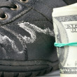 Closeup of a winter boots damaged by reagents and money — Stock Photo