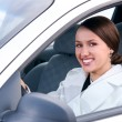 Royalty-Free Stock Photo: Happy business woman in a car is looking at camera