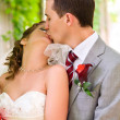 Bride and groom are kissing at park — Stock Photo