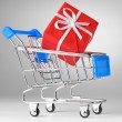 Closeup of a shopping cart with gift — Stock Photo #4748943