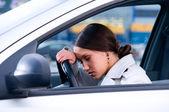 Beautiful woman is sleeping in a car — Stock Photo
