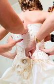 Bride friends are helping to dress her before wedding — Stock Photo