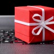 Red gift box on a laptop keyboard — Stock Photo #4892085