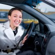 Business woman is laughing in her car — Stock Photo