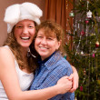 Happy mom and daughter at home before christmas — Stock Photo