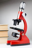 Books and microscope, scientific or educational concept — Stock Photo