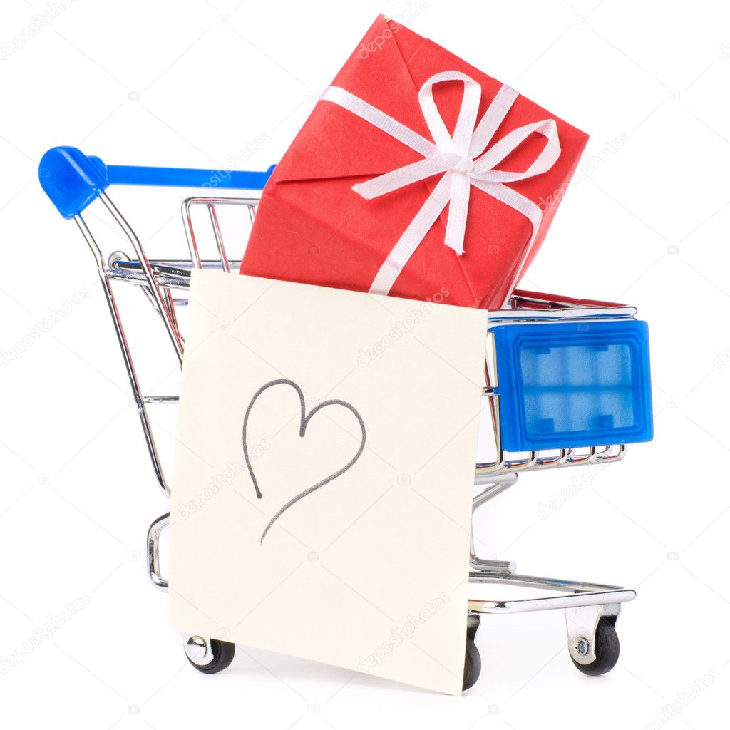 Closeup of a shopping cart with gifts and heart — Stock Photo #4892097