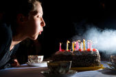 Blowing out candles on cake — Stock Photo