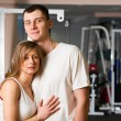 Couple in gym - Stock Photo