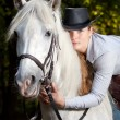 Young Lady hugging her horse — Stock Photo #3987899