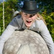 Young Lady riding a horse — Stock Photo