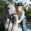 Stock Photo: Young Lady riding a horse