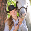 Young Lady hugging her horse — Stock Photo #4090726