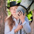 Young Lady hugging her horse - Stock Photo