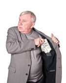 Elderly man puts money in an internal pocket of a jacket — Stock Photo