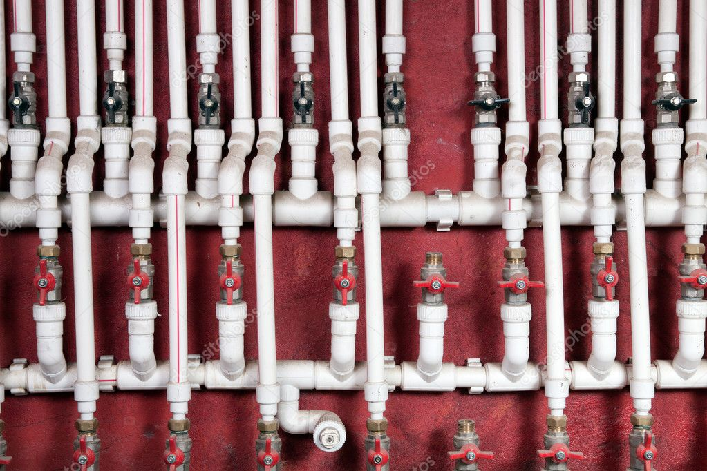 White water pipes against a red wall — Lizenzfreies Foto #4747749