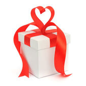 Gift box, bow and heart — Stock Photo