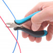 Royalty-Free Stock Photo: Hand, pliers and cable
