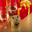 Two glasses and box with gifts — Stock Photo #3996963