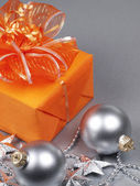 Christmas gift with decorations — Stock Photo