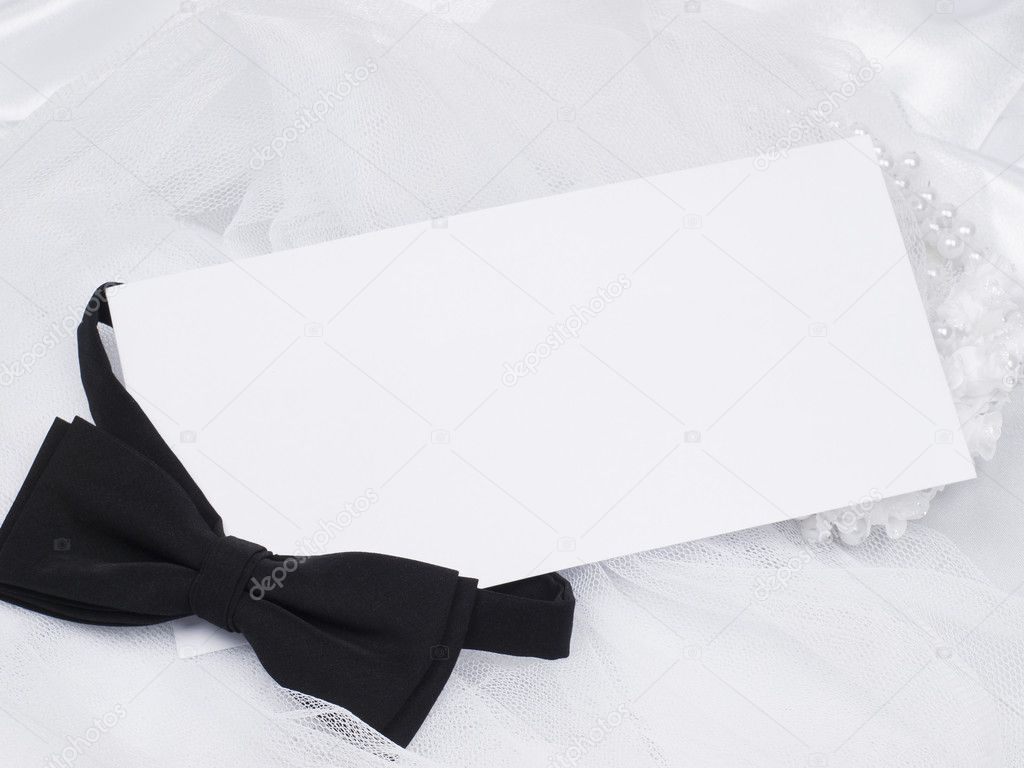 Card, bridal  veil and bow  on a background white silk  Stock Photo #4603390