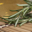 Fresh rosemary with warm massage oil in spa — Stock Photo #4653843